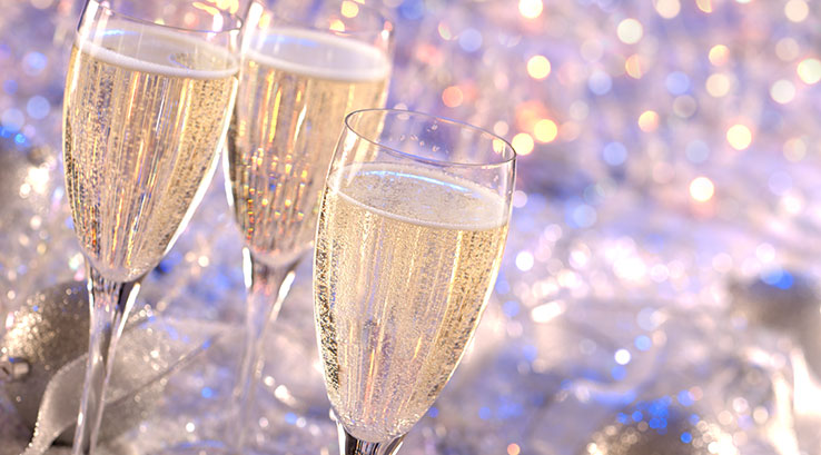 Champagne glasses with a party background