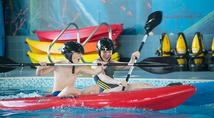 Kids kayaking in pool