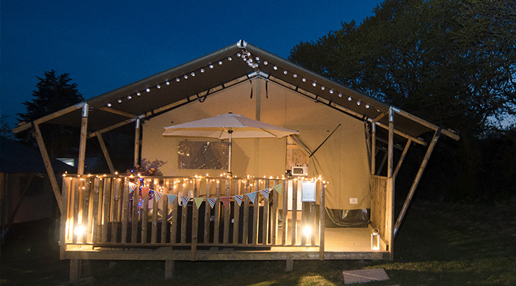 Glamping Safari Tent at night with fairylights, near Isle of Wight