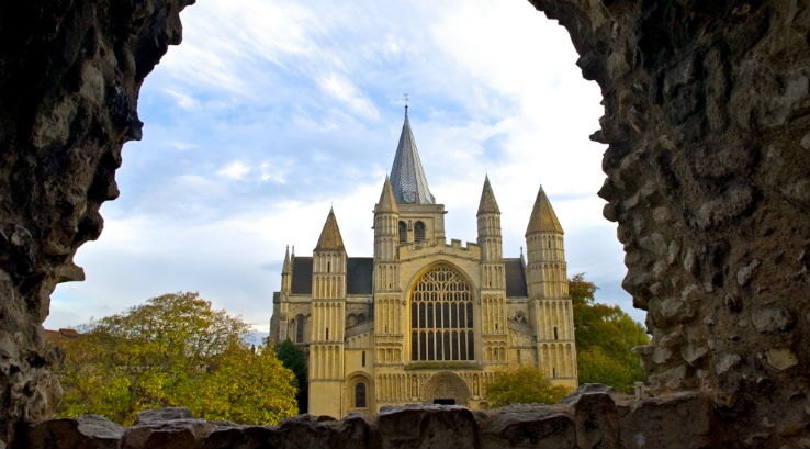 Rochester Cathedral viewed through a stone wall