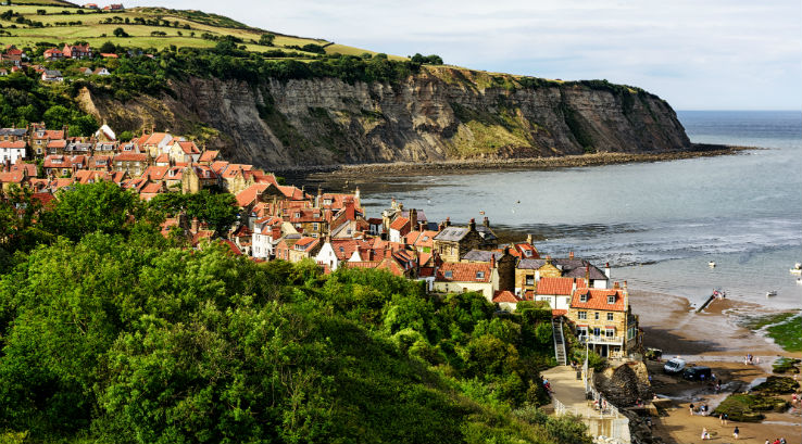 A view overlooking Robin Hood's Bay beach and town in North Yorkshire