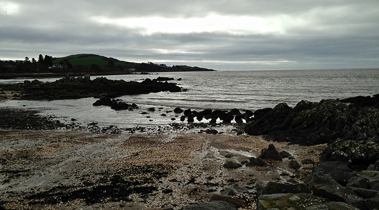 Cloudy skies over Rockcliffe Beach in Scotland