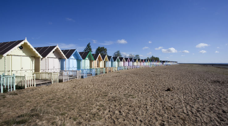 Colourful beach huts overlooking West Mersea Beach in Essex