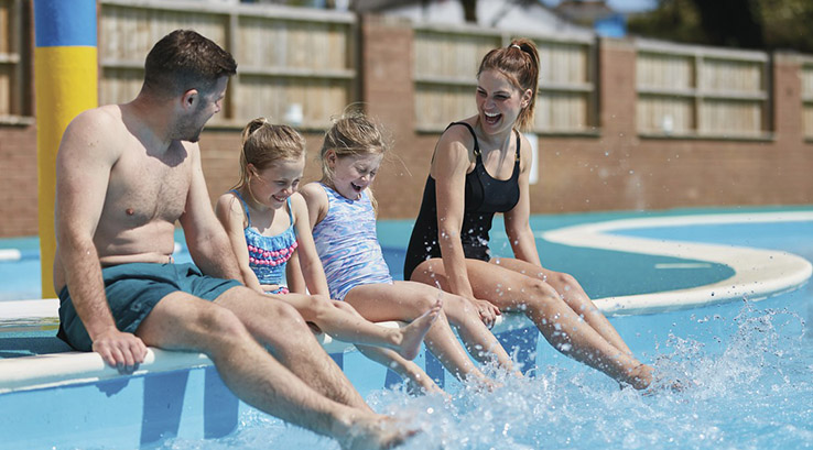 Family making a splash in the outdoor pool