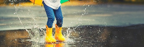 Kid jumping in puddle