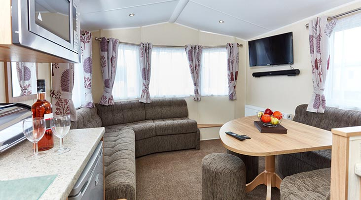 The lounge in one of our cosy caravans, with lots of space