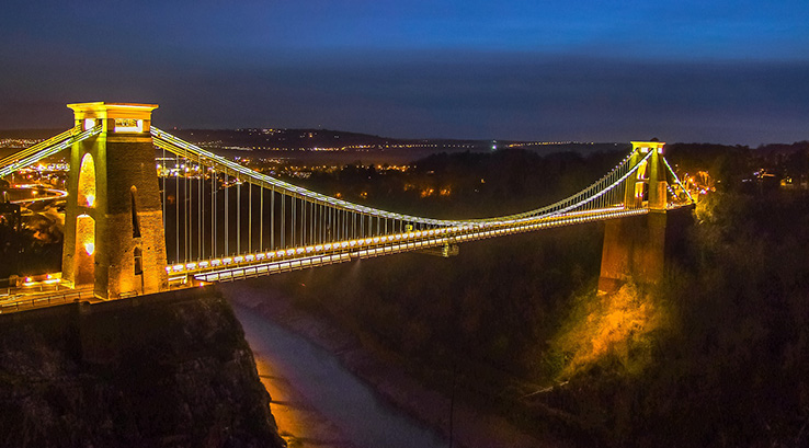 The Clifton Suspension Bridge in Bristol, lit up at night