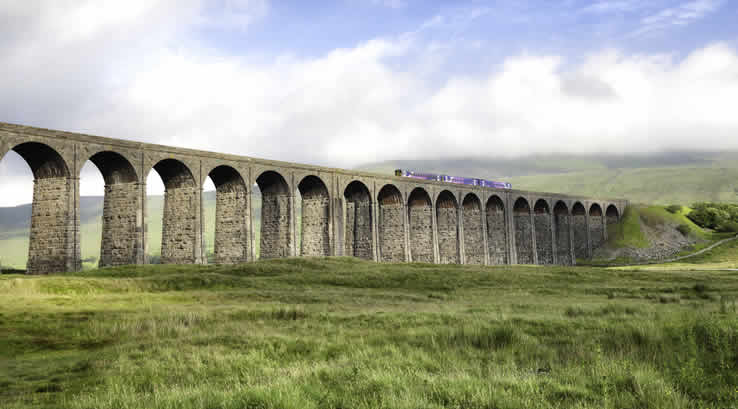 Train crossing the Ribblehead viaduct