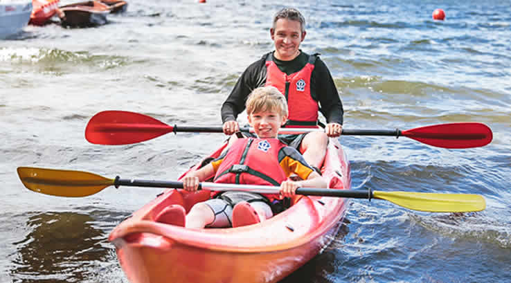 Father and son kayaking at Brockhole