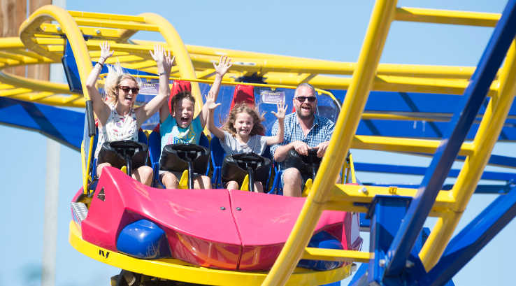Family having fun on a roller coaster at Crealy Great Adventure Park
