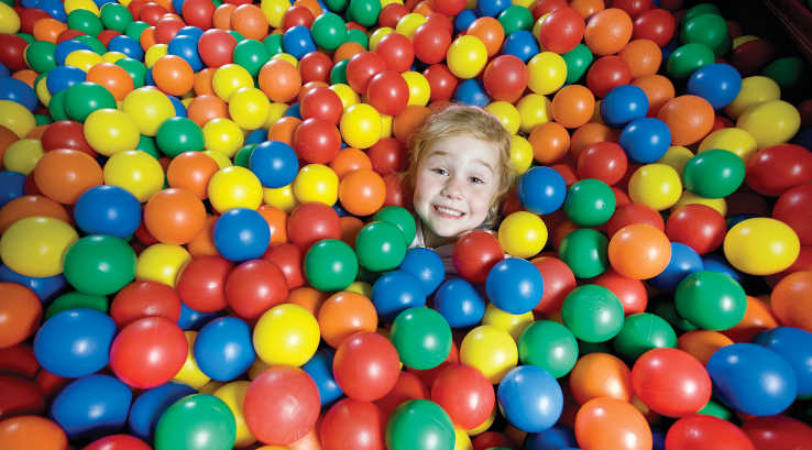 Little girl in ball pit
