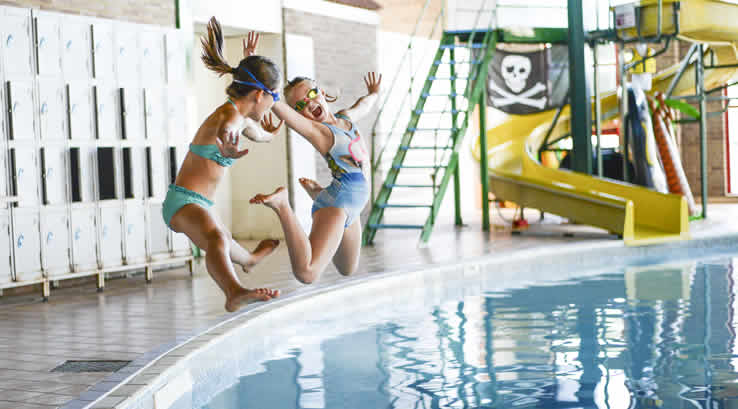 Children jumping into the indoor pool at Landguard