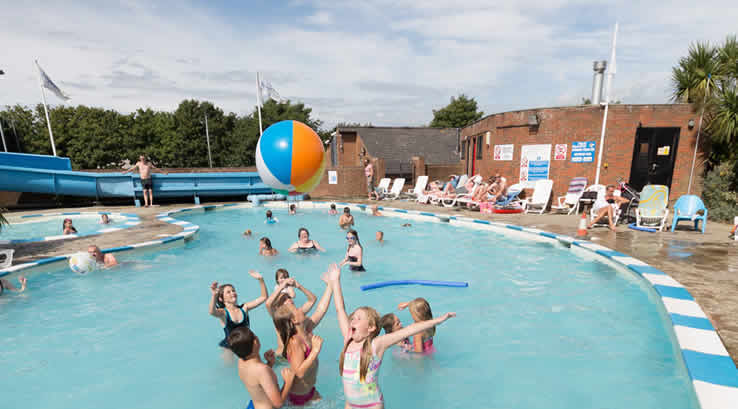 Children having fun in the outdoor pool at Lower Hyde