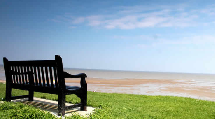 A park bench overlooking Minster Leas Beach