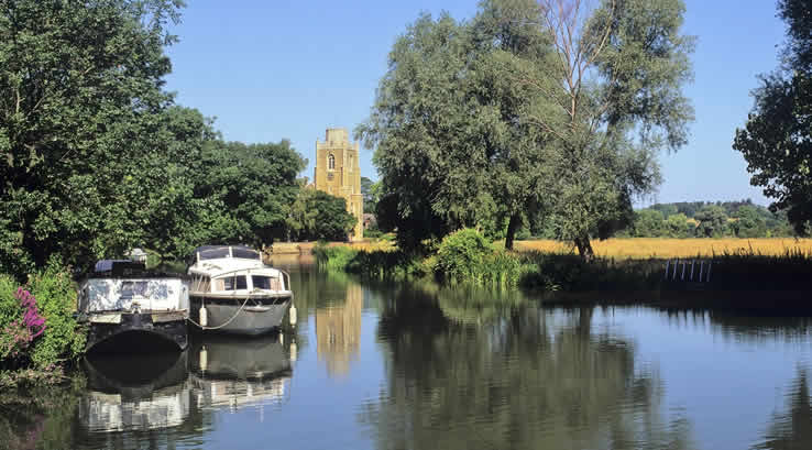 Barges on a canal at the Norfolk Broads