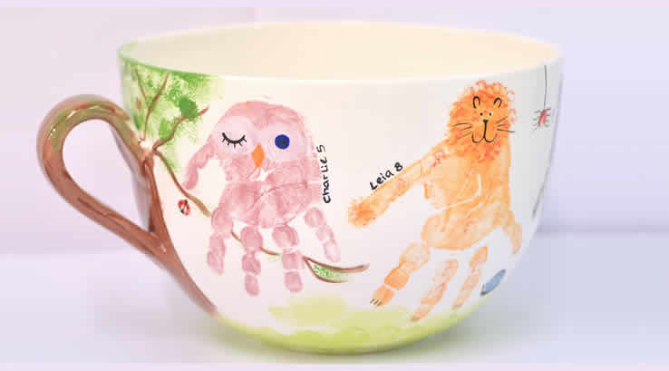 A hand-decorated tea cup