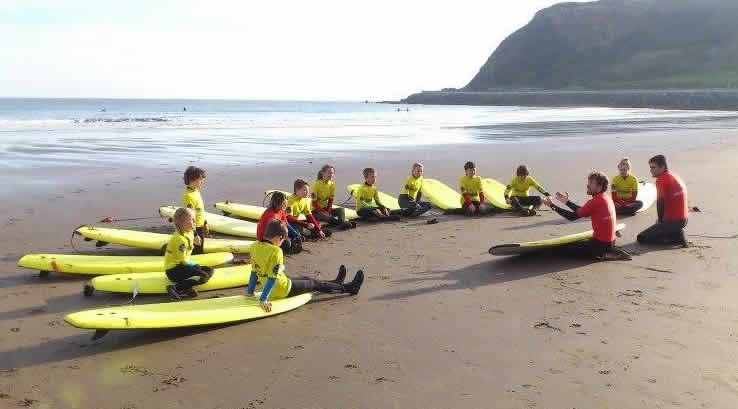 A surfing lesson on the beach at Scarborough
