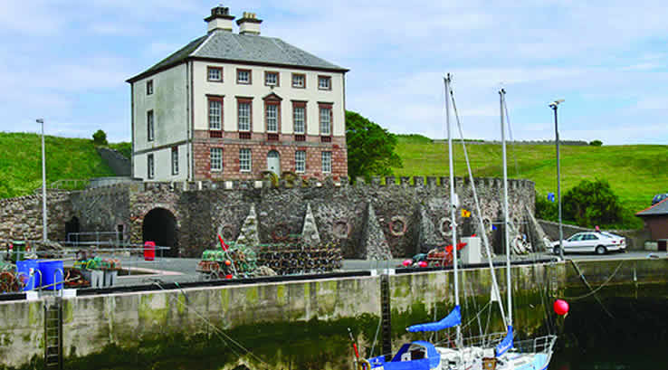 Gunsgreen House, with fishing boats in the foreground