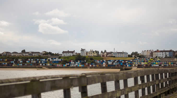 Walton beach huts. View from pier