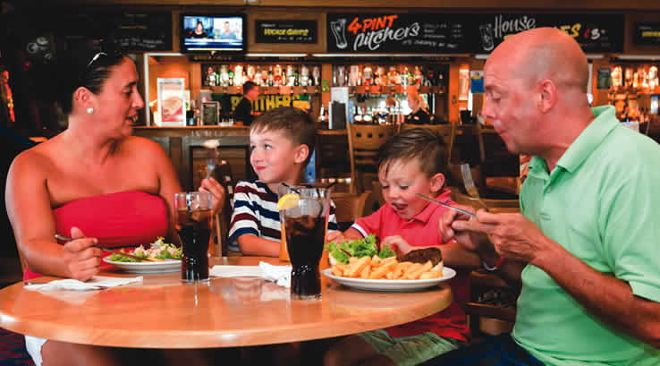 Family enjoying a meal in the Waterside Tavern
