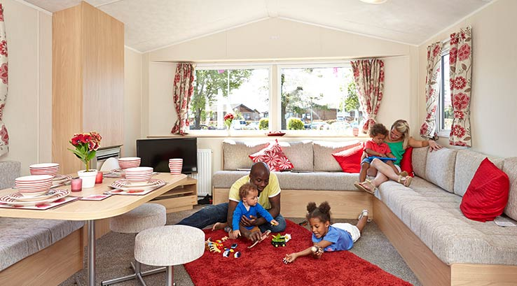 Young children playing with toys in their lodge.