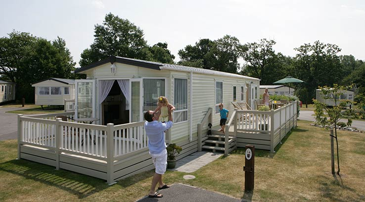 Family having fun outside their holiday home.