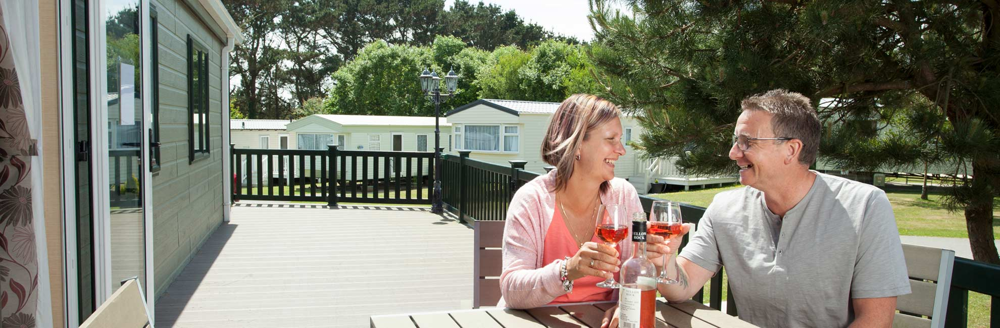 Couple relaxing with wine on their veranda