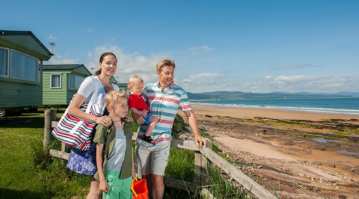 Family looking out at the beach at Grannie's Heilan' Hame.