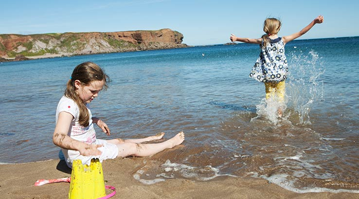 Fun in the sea at Eyemouth Beach