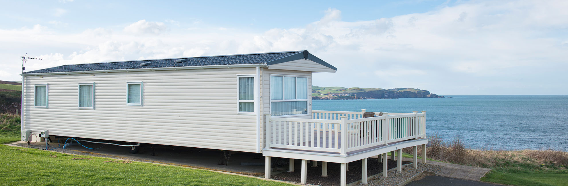 A caravan with a veranda overlooking the sea at Eyemouth Holiday Park