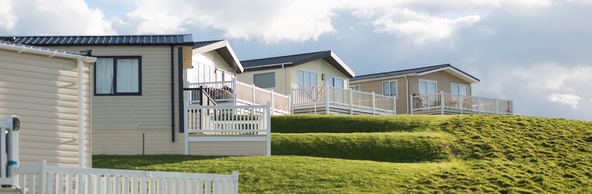 Lodges with verandas at Eyemouth Holiday Park