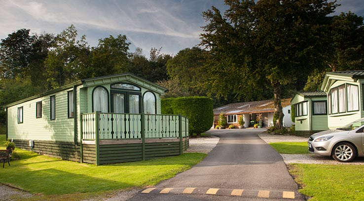 Green painted lodges at Gatebeck