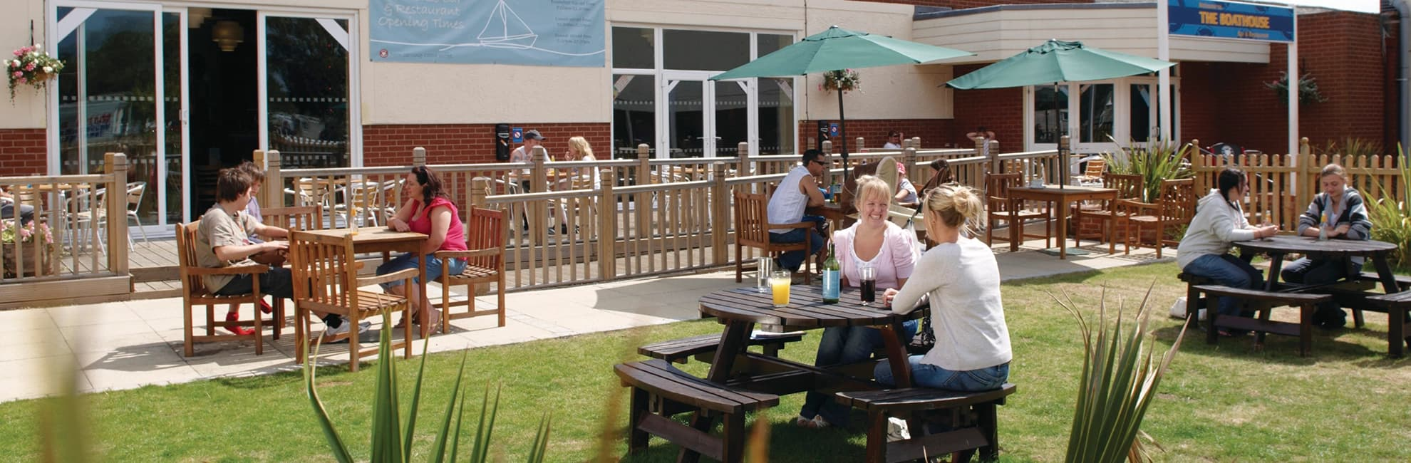People relaxing in the beer garden at Highfield Grange Holiday Park