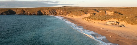 Children walking to Holywell Bay beach