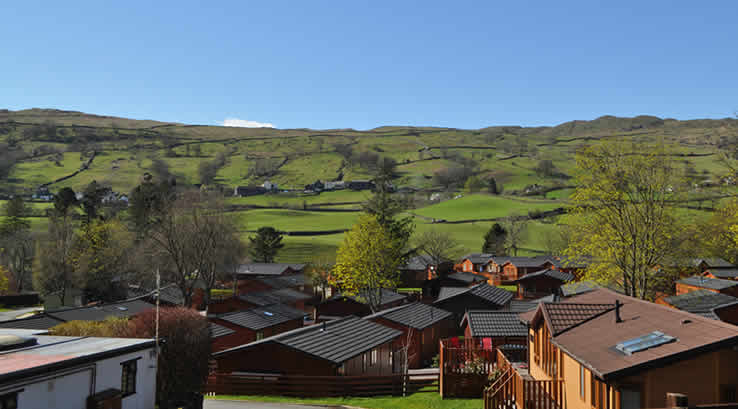 View of lodge rooftops with countryside in background