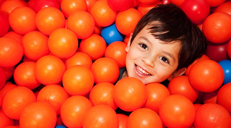 Fun in the ball pit at soft play