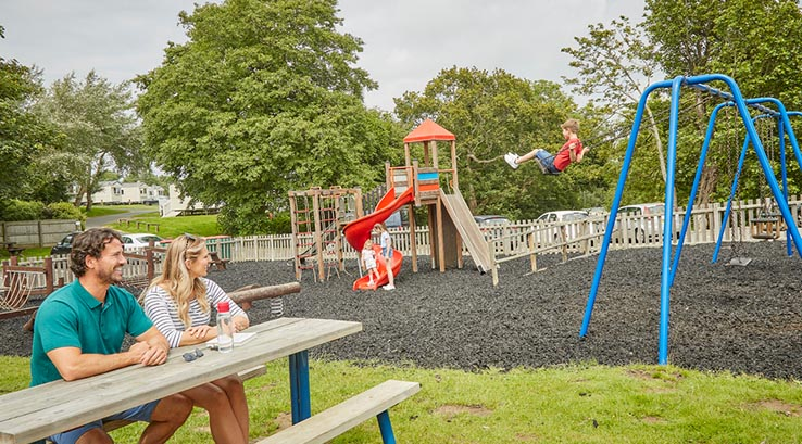 Having fun on the slide at the play park