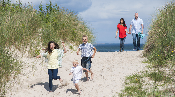 Family building sandcastles on the beach at Nairn Lochloy
