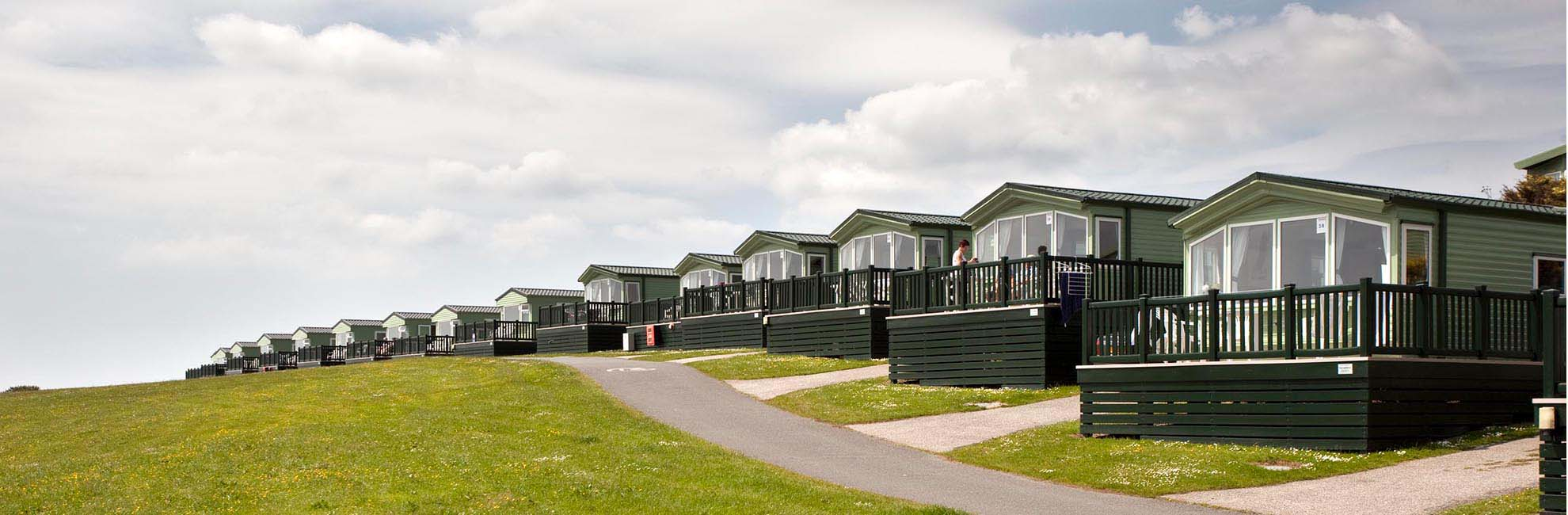 Lodges with verandas at Sea Acres Holiday Park