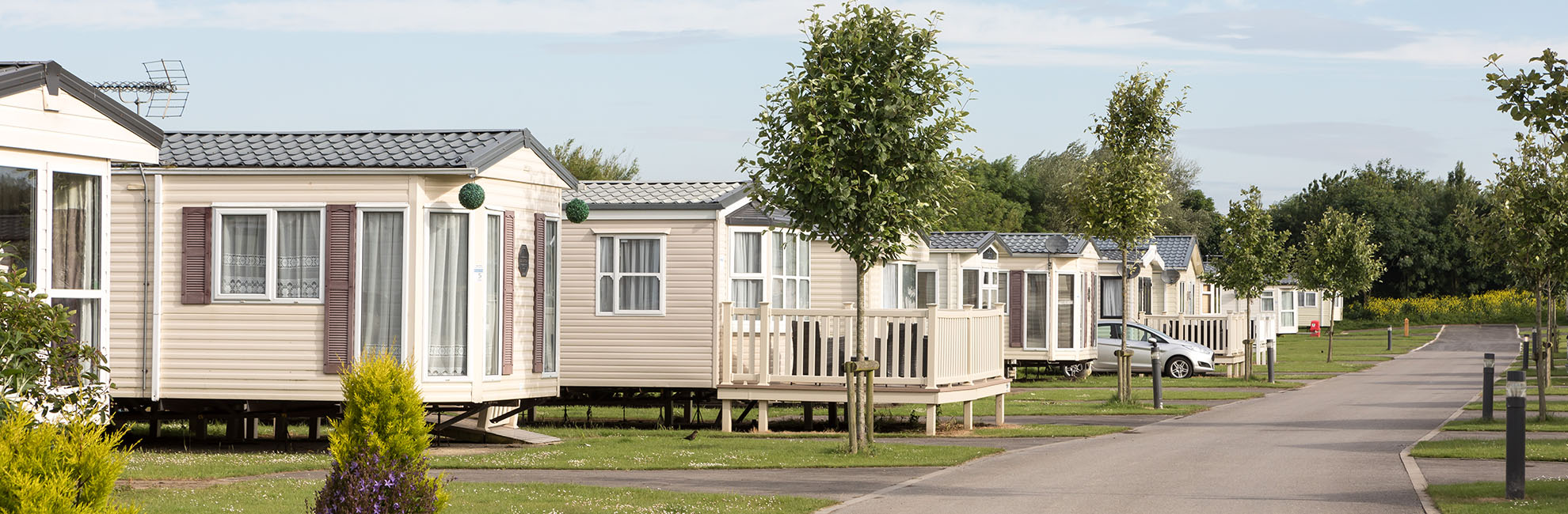 Couple walking through Skipsea Holiday Park