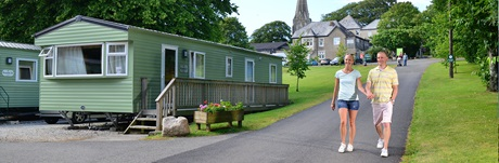 Couple walking through St Minver Holiday Park