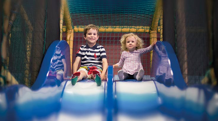 Fun on the slide at soft play