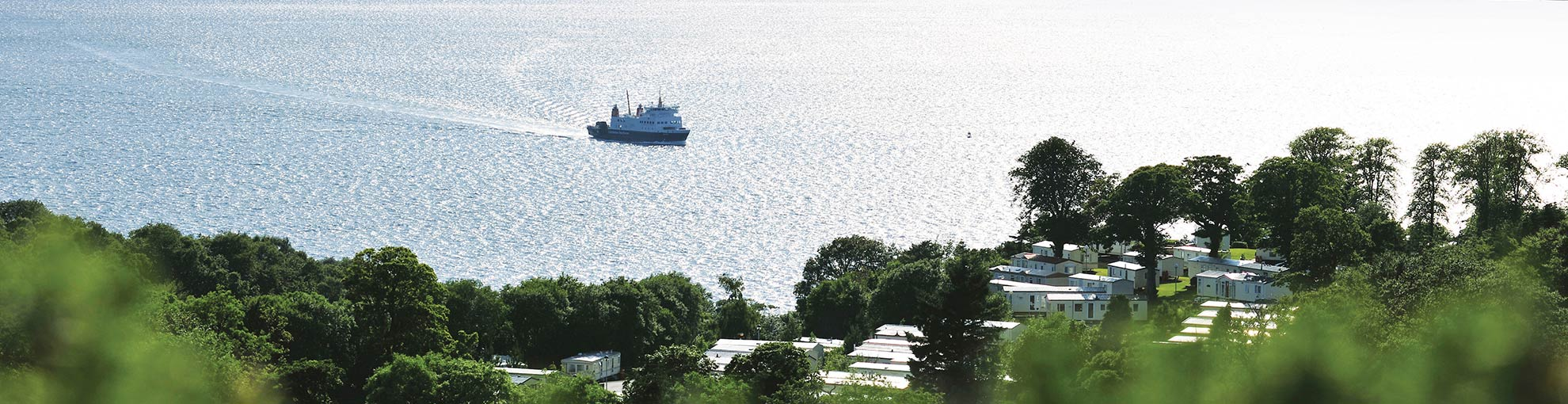 View of a boat on the Firth of Clyde from Wemyss Bay Holiday Park