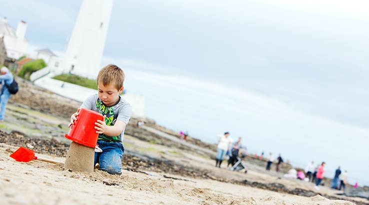 Building a sandcastle at Whitley Bay beach