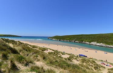 Wide shot of Crantock Beach and the sea