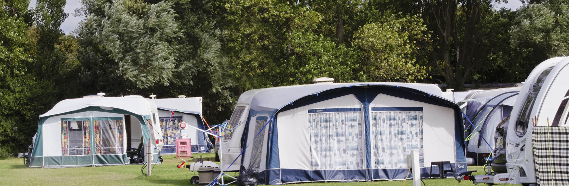 Caravans and awnings at a Parkdean Resorts campsite in Essex