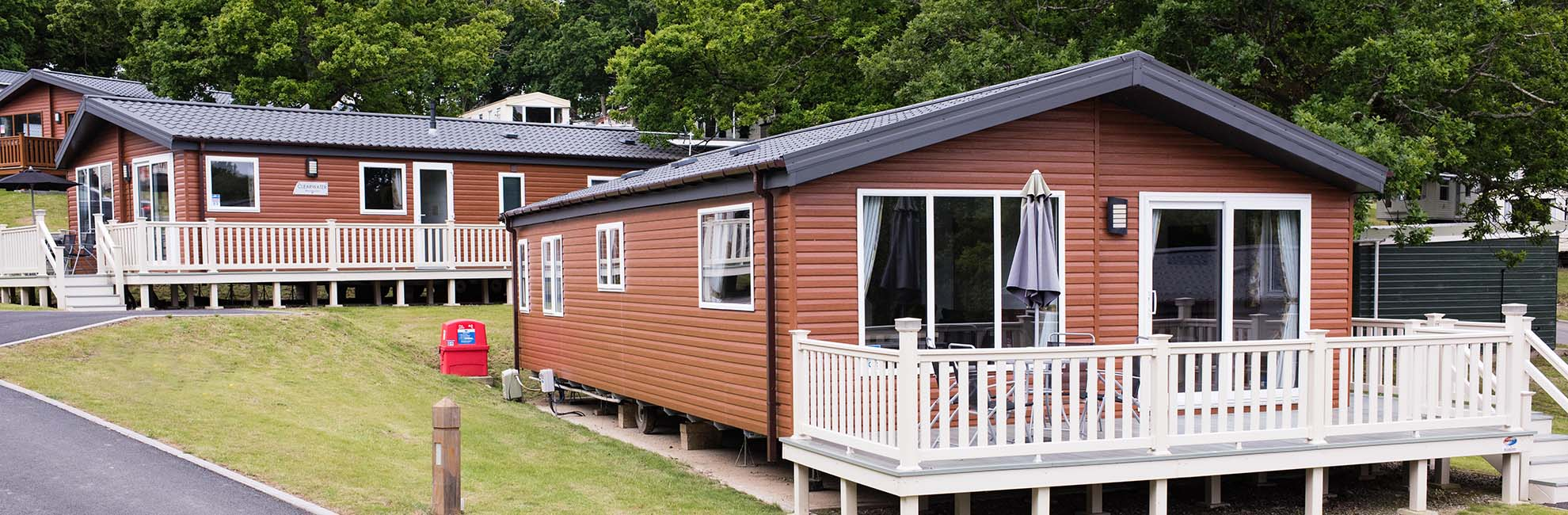 Luxury lodges for sale on a landscaped hillside at Thorness Bay Holiday Park on the Isle of Wight