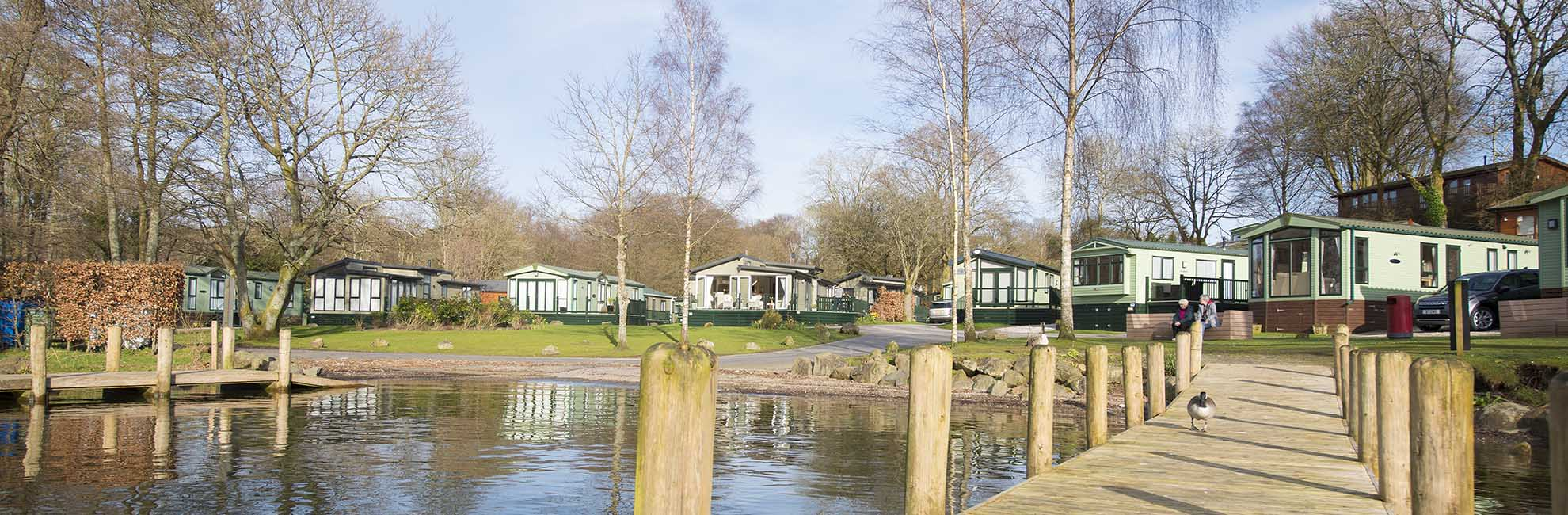 Lodges by the lake at a Lake District holiday park
