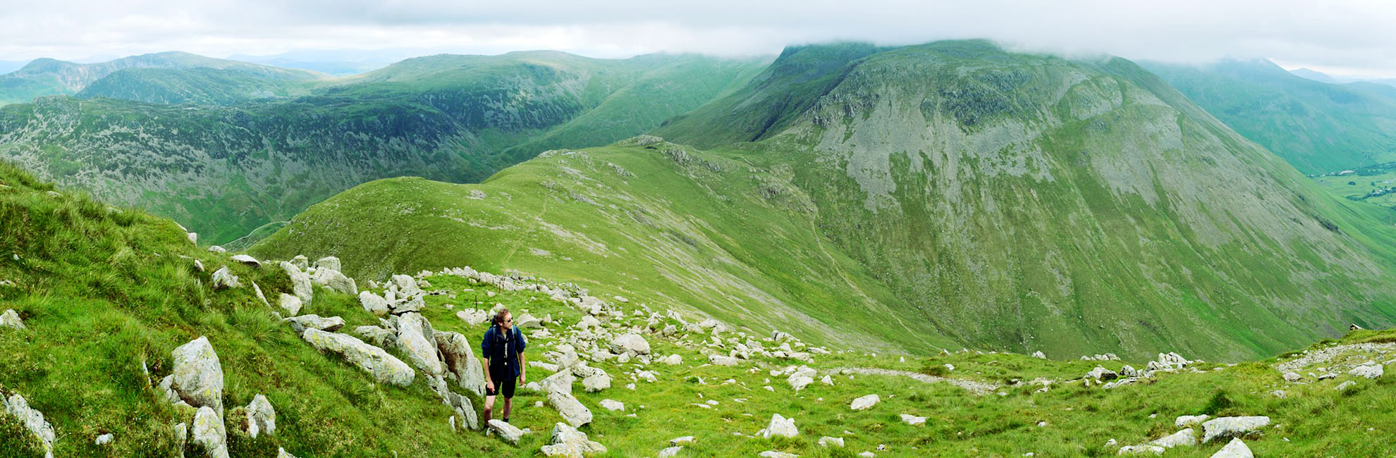 A man hiking up the mountains in the Lake District