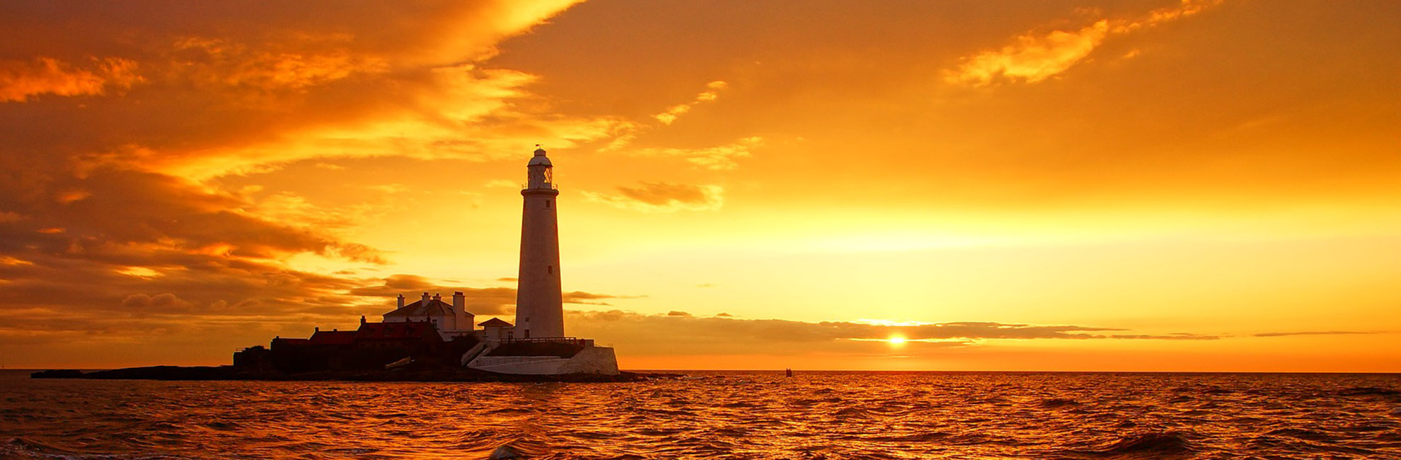 Sunset over St. Mary's Lighthouse in Whitley Bay